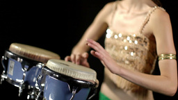 beautiful female percussion drummer performing with bongos Footage