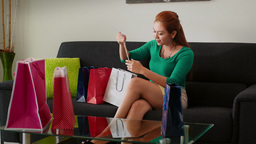 Latina Girl With Shopping Bags Relax On Sofa stock footage