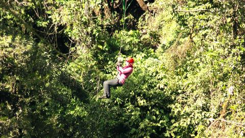 Woman on zipline slow motion Footage