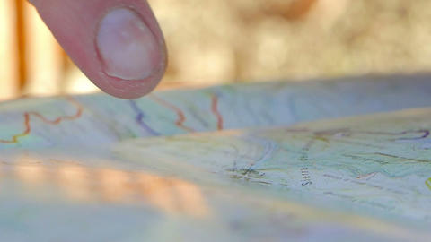 Young adult man pointing on the map Stock Video Footage