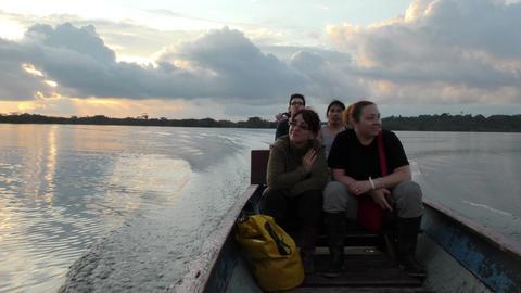 Group of tourist on Laguna Grande Cuyabeno at sunset Footage