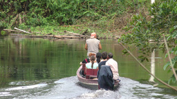 Tourists on motorized canoe in Amazonian jungle Footage