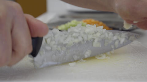 Home cook dicing an onion. 4K UHD Footage