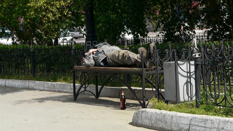 man sleeping on a bench Stock Video Footage