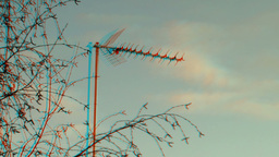 Rooftop television antenna behind the trees 1 (combo) Stock Video Footage