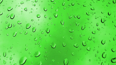 4k waterdrops on green background Footage