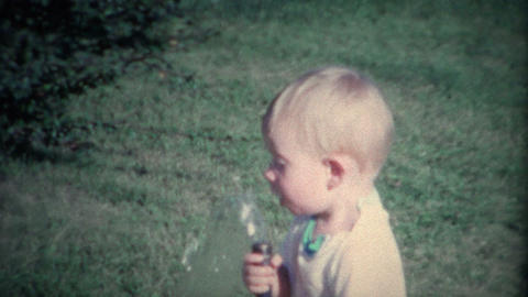 (8mm Vintage) Little Boy Drinking From Outdoor Garden Hose stock footage