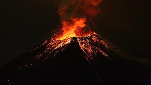Tungurahua Volcano Exploding By Night stock footage