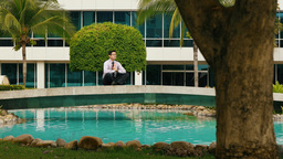 Businessman Meditating Doing Yoga Outside Office Building stock footage