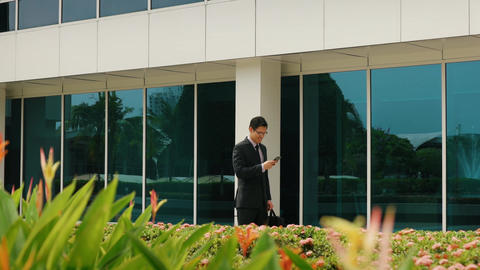 Businessman Chatting On Mobile Phone Walking To Office Footage
