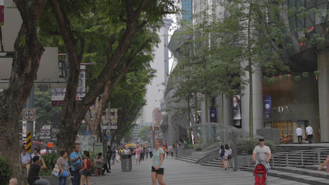 caucasion mom follows baby on orchard road Footage