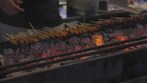 satay sticks being cooked on charcol Footage