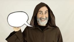 Friar holding white speech balloon happy Footage