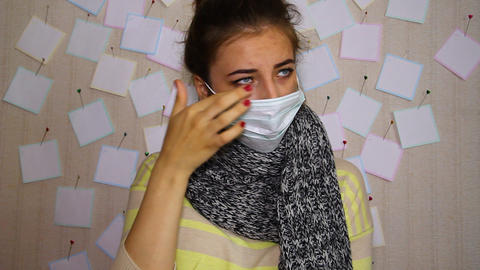 Young sick girl in a mask coughs, sits and waits to see a doctor Footage