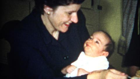 (8mm Vintage) Mom Feeding Baby 1956 Footage