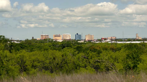 Sparse Downtown City Skyline Wichita Falls Texas Clouds Passing ビデオ