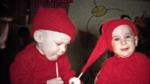 (8mm Vintage) Dressing Up Kids As Santa's Elves Footage