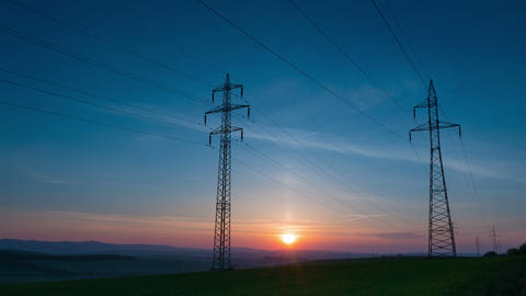 Power Line and Sunrise. Time Lapse UHD Footage