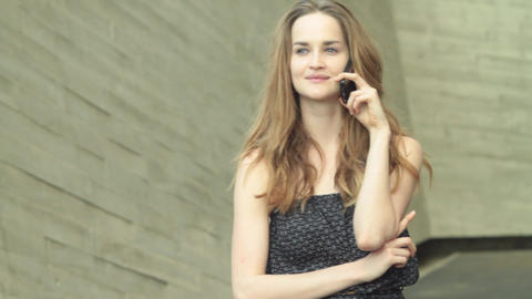 beatiful girl model talking on a mobile phone and searching for friend Footage