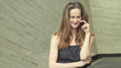 Laughing Beatiful Girl Model Talking On A Mobile Phone stock footage