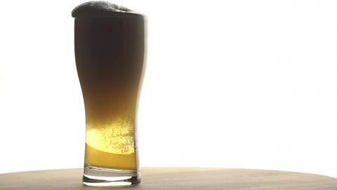 Beer is Poured into a Tall Glass Footage