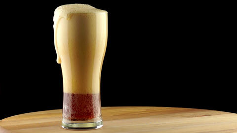 Dark Beer is Poured into a Tall Glass Footage
