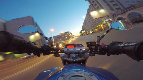 Riding a motorcycle in a city Footage