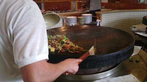 Big wok mongolian bbq with large pan, meat and vegetables Footage