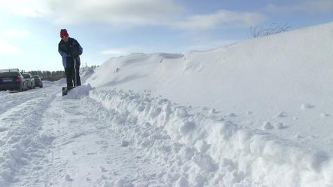 Man Shoveling Snow Videos de Stock