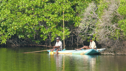 Two men in Sri Lanka fishing in a tropical lake Footage