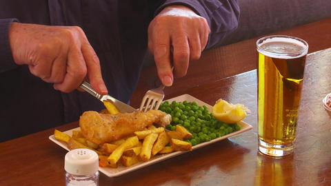 Salting fish and chips Footage