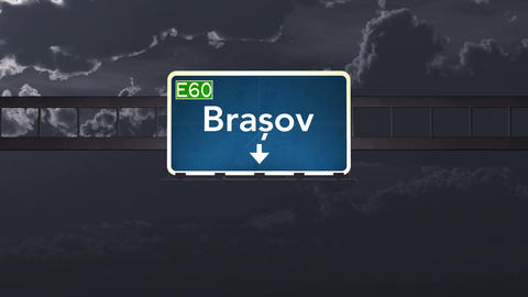 4K Passing Brasov Romania Highway Sign At Night With Matte 1 Neutral stock footage