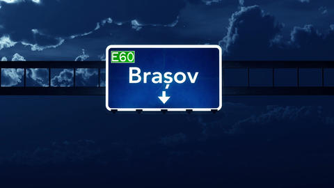 4K Passing Brasov Romania Highway Sign At Night With Matte 2 Stylized stock footage