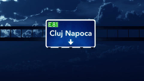 4K Passing Cluj Napoca Romania Highway Sign At Night With Matte 2 Stylized stock footage