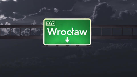 4K Passing Wroclaw Poland Highway Sign at Night with Matte 1 neutral Animation
