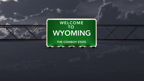 4K Passing Wyoming USA State Border Welcome Road Sign At Night With Matte 1 Neut stock footage