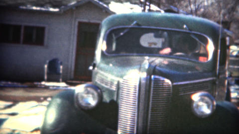 (8mm Film) 1949 Man Backing Up New Car Footage