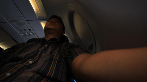Young Man On Airplane Looking Outside stock footage