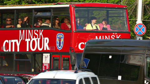 "Red Bus With Caption ""Minsk City Tour"" Rides on Street Footage"