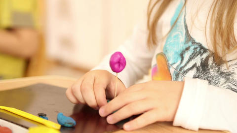 Young children are sculpting figures of plasticine Footage