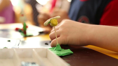 Young children are sculpting figures of plasticine Stock Video Footage
