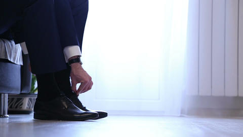 The man wears black shoes Footage