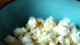 Pouring Popcorn Into a Turquoise Bowl Footage