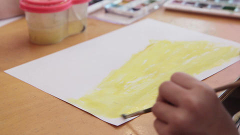Little girl drawing with paint and paintbrush Footage