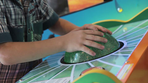 A young boy playing game machine Footage