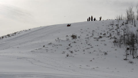 Snow tubing from snow covered hill top Footage