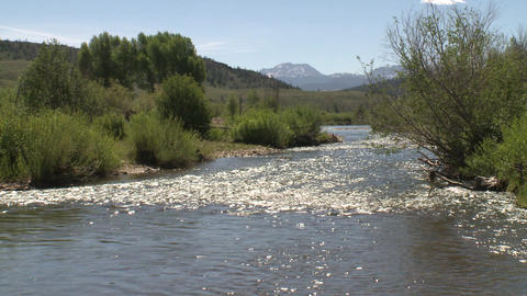 River In Colorado With Continental Divide In Background stock footage