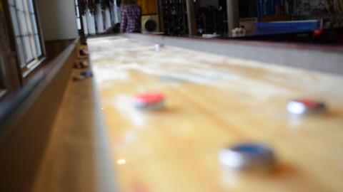 Shuffleboard in gameroom Footage