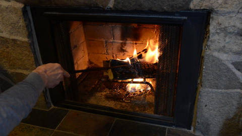 Fire Place- Stocking The Fire stock footage