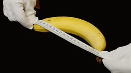 Banana Measuring Tape Metaphor stock footage